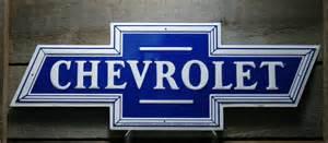 metal die cut chevrolet bowtie tin sign corvette garage
