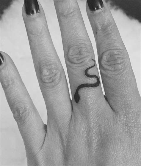 snake tattoo   middle finger   ron smith