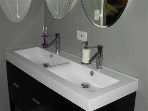 single basin bathroom sink with two faucets