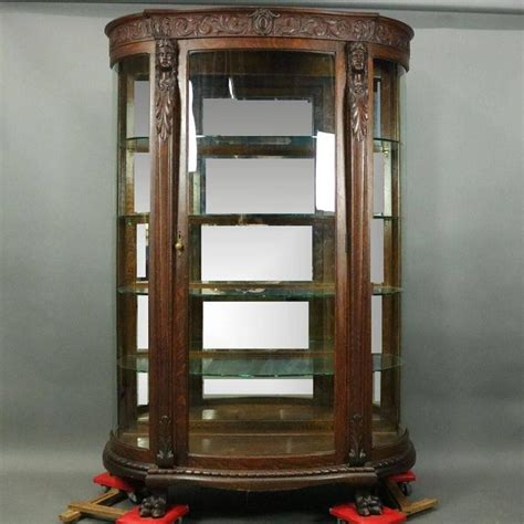 R.J. Horner Bros. Figural Carved Oak Mirror Back China Cabinet, circa 1890 at 1stdibs