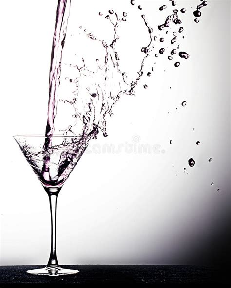 martini glass spilling beverage pour stock image image of alcohol served