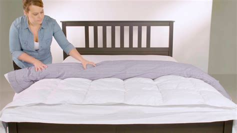 can you put a down comforter in a duvet cover video how to put on a duvet cover real simple
