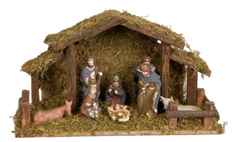 wood crib nativity with ceramic nativity