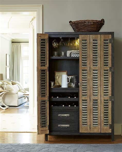 Universal Furniture Bar Cabinet Universal Moderne Muse Libations Locker With Tri Fold Doors Belfort Furniture Bar Cabinet