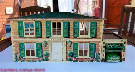 dolls house garage mettoy tinplate dolls house and garage 1950s tin doll houses pinterest garage