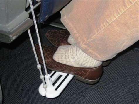 comfort on long flights zarcor inc introduces carry on airplane footrest