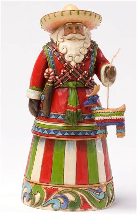 feliz navidad traditions feliz navidad santa claus figurines and carved