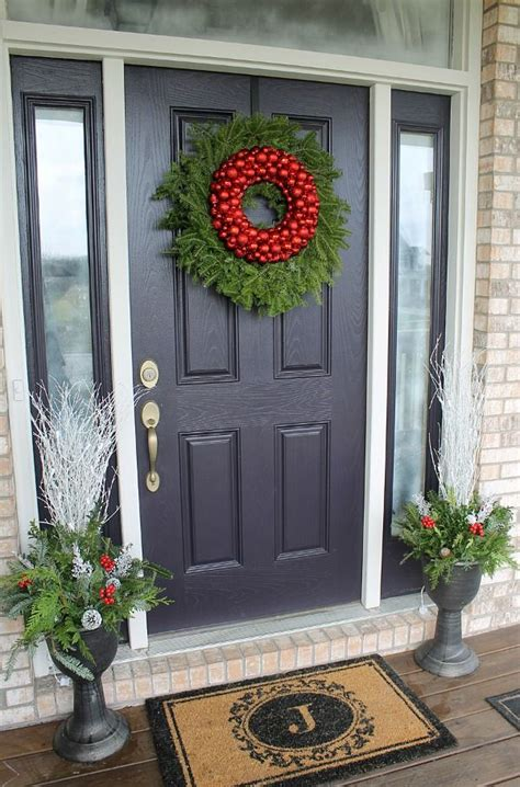 front door decor christmas how to decorate your front door for the holidays the lovely look of simple festivity