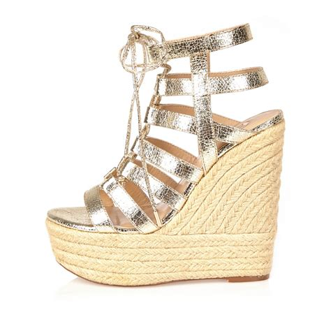 Wedges Gloss Gold river island gold gladiator wedges in metallic lyst