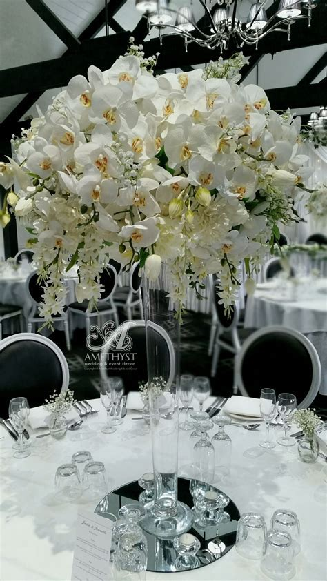 Tall White Orchid Centerpiece   more info >>