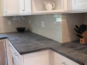 black soapstone kitchen with white subway tile backsplash