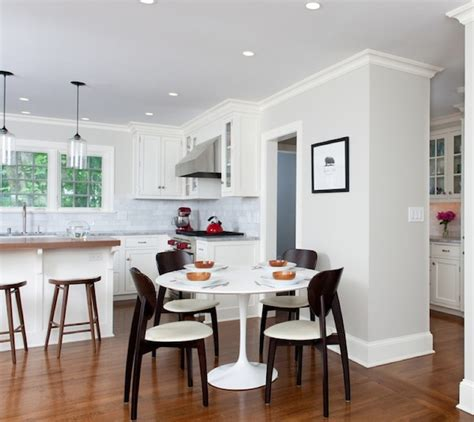 enhancing your kitchen dining area with a table