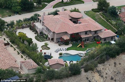 kris jenners address kylie jenner has her face painted on her mansion wall as