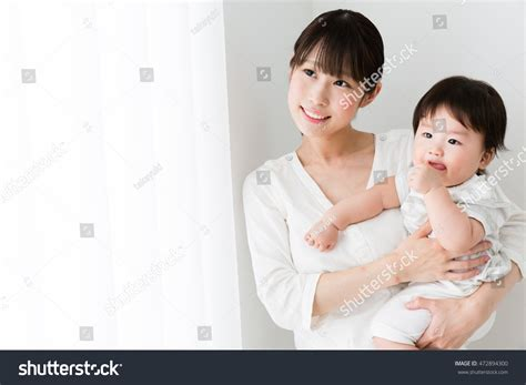 asian mother and son bedroom portrait stock photo getty portrait asian mother baby room stock photo 472894300