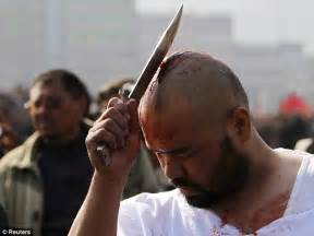 slashing themselves with chained blades bloodied muslims - With Them Selves