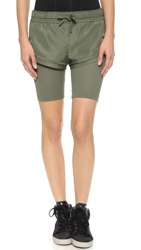 adidas by stella mccartney running shorts loam in green lyst