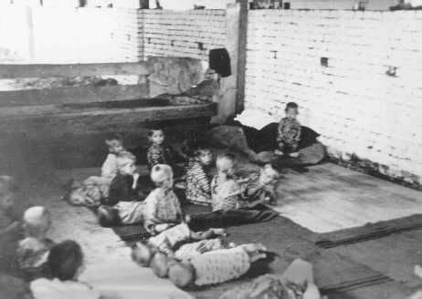 serbia elveia children sit and sleep on the floor at sisak a ustasa