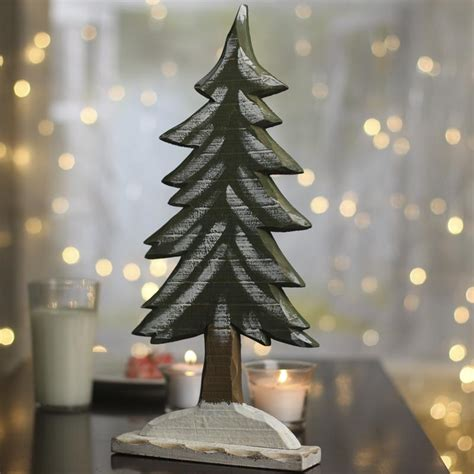 rustic wood snowy tree christmas and holiday primitive