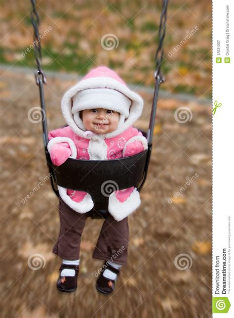 swinging a baby swinging baby playground royalty free stock photography
