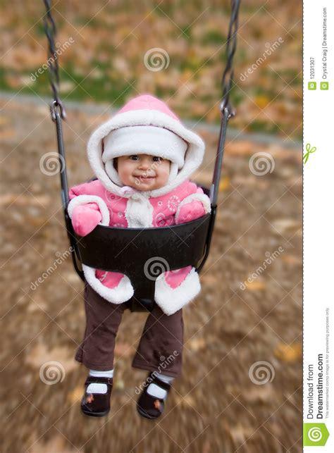 baby swinging video swinging baby playground royalty free stock photography