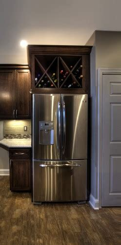 wine storage above kitchen cabinets take cabinet doors off above fridge and convert to wine