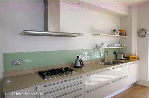 Glass backsplash, no upper cabinets, white lower cabinets