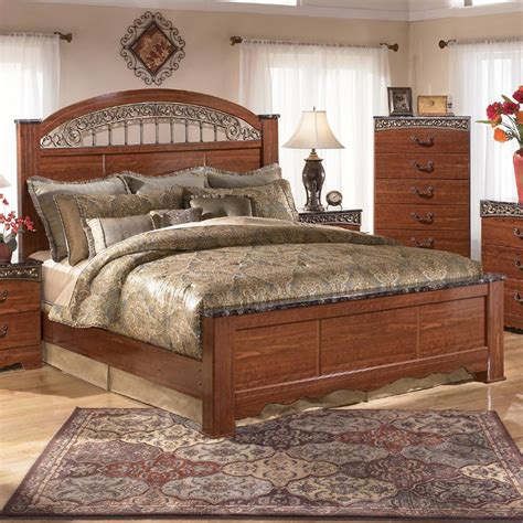 king poster bed  ornate scrolled insert  signature design  ashley wolf furniture