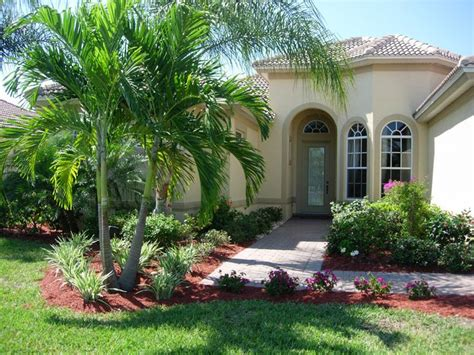 front yard landscping with border and palms front