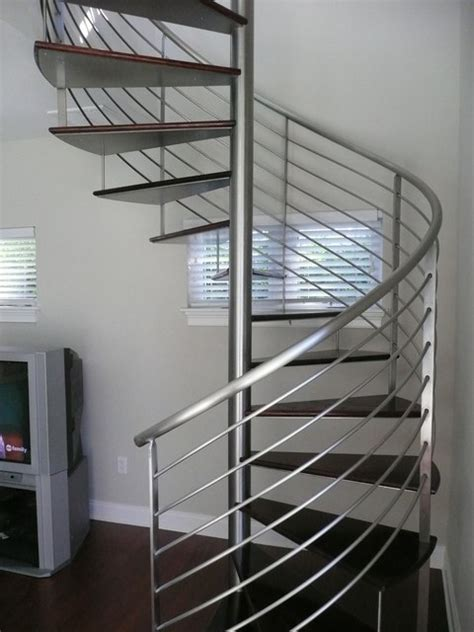 Kerala Home Design Latest by Spiral Stairs