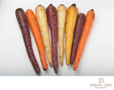 different colored carrots different colored fresh picked assorted carrots and