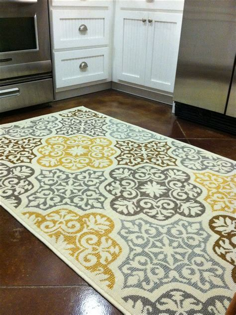 area rug in kitchen kitchen rug purchased from overstock blue grey yellow brown home decor kitchen decor