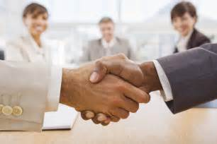 Business Partnership Sle by Portrait Of Happy Businesspeople Shaking Crestone Business Crestone Business