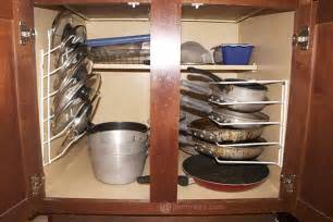 Organize Pots And Pans In Cabinet Organizing Your Pots And Pans Jamonkey