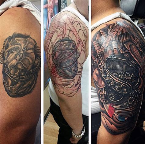 cool upper arm tattoos 100 barber tattoos for masculine design ideas