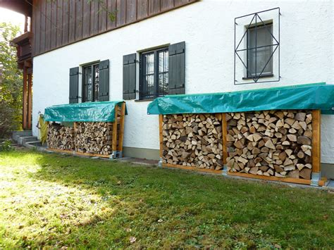 diy firewood rack with cover small and narrow side yard spaces with firewood stacked in diy outdoor rack storage ideas