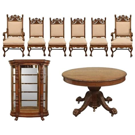 ornately carved oak dining room set with table chairs and