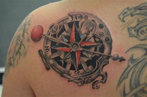 realistic back compass tattoo by freaky colours