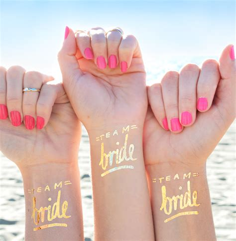 team bride gold tattoos wedding bags