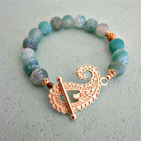 blue green cracked agate beaded bracelet with gold toggle