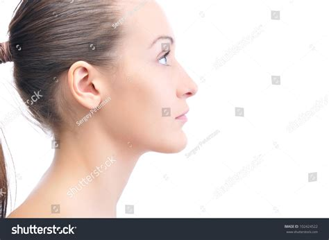 hair i woman s chin sideways happy beautiful young woman looking sideways stock photo
