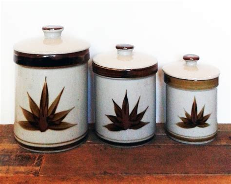Stoneware Kitchen Canisters by Sale Set Of Three Stoneware Kitchen Canisters One Small