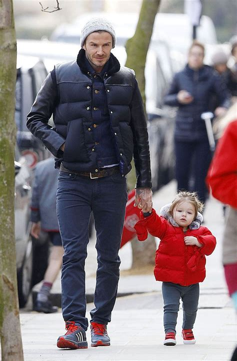 david beckham wearing navy quilted gilet navy denim