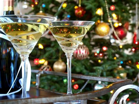 holiday cocktails background crystal glasses with wine bottle on the christmas tree