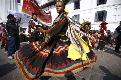 new year parade costume a gurung in a traditional costume performs during the