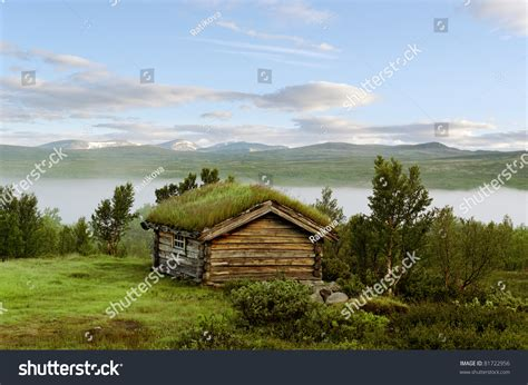 house on a hill small house on hill norway mountains stock photo 81722956