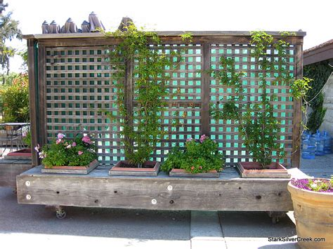 Privacy Fence Planter Box by Movable Privacy Fence On Casters With Built In Planters
