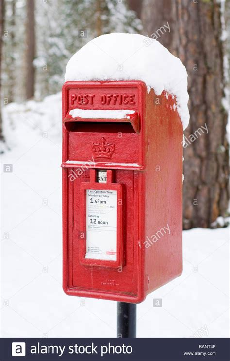 a post office letter box or mailbox in the snow near
