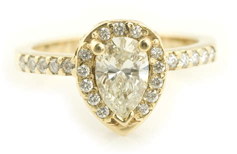 pear cut halo engagement ring in yellow gold