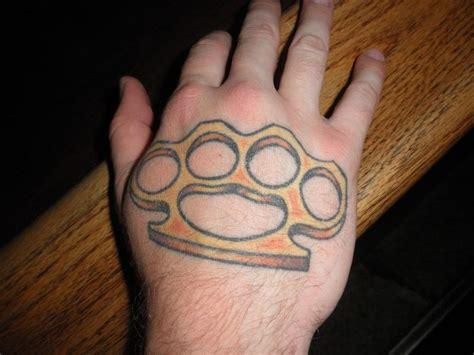 tattoo back hand brass knuckle tattoo on back hand tattoomagz