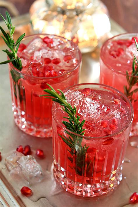 christmas liquor pomegranate and rosemary gin fizz cocktails drinkwire